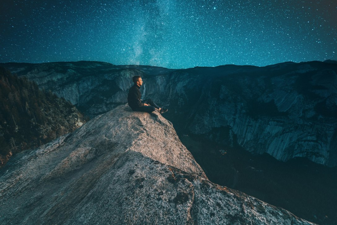 person sitting on mountain